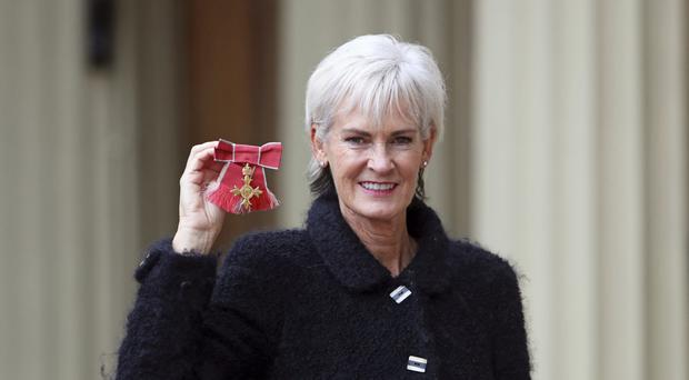 Judy Murray received her OBE for services to tennis, women in sport, and charity (Steve Parsons/PA)