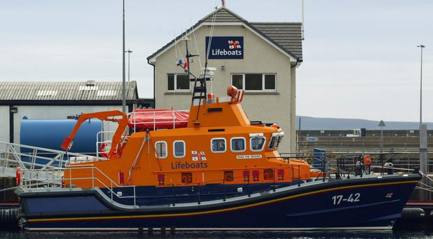 A lifeboat was launched from Scrabster Harbour just after noon on Thursday and found the fishing vessel disabled and drifting in heavy seas (David Cheskin/PA)