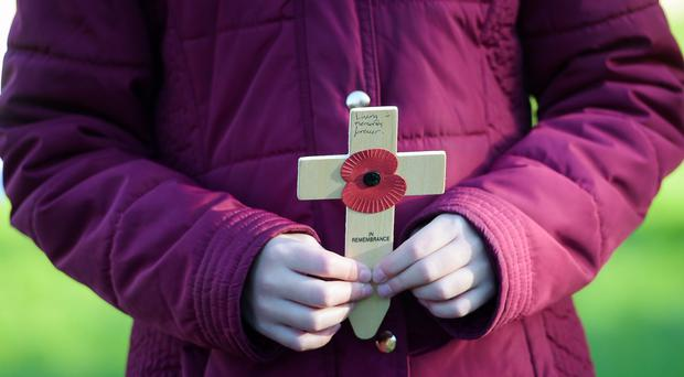 Children carry crosses in the Royal Wootton Bassett Field of Remembrance (Ben Birchall/PA)