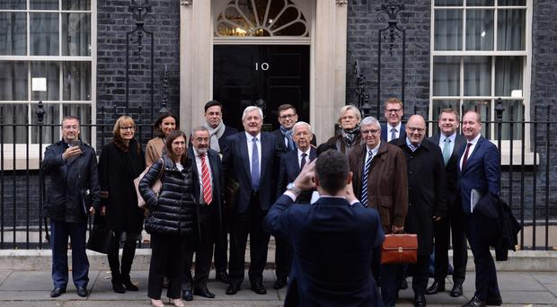 Business leaders from Europe and the UK pose for a group photo as they leave 10 Downing Street (Stefan Rousseau/PA)