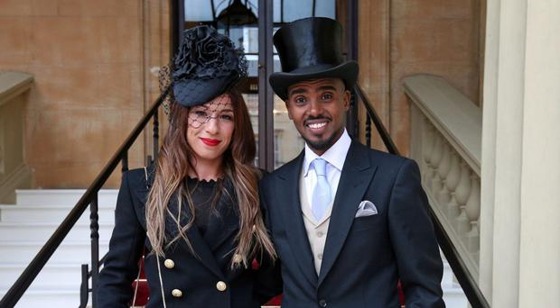 Sir Mo Farah with wife Tania arriving at Buckingham Palace (Jonathan Brady/PA)