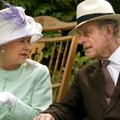 The Queen and the Duke of Edinburgh in 2002 (Fiona Hanson/PA)