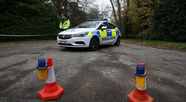 A policeman stands guard at the entrance to Waddesdon Manor Road in Buckinghamshire after a fatal air crash (Aaron Chown/PA)