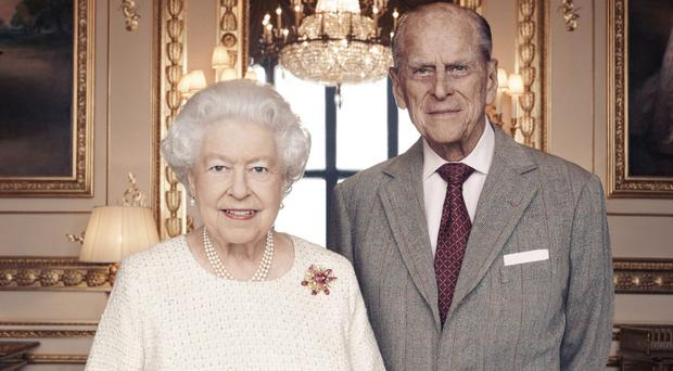 Queen Elizabeth II and the Duke of Edinburgh in the White Drawing Room at Windsor Castle in celebration of their platinum wedding anniversary (Camera Press/PA)