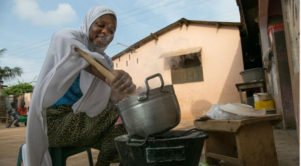 Woman using cookstove in Ghana