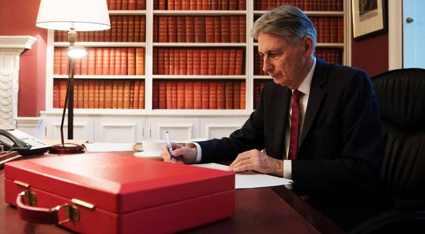 Philip Hammond prepares his speech in his office in Downing Street (Christopher Furlong/PA)