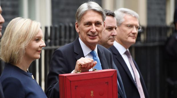 Philip Hammond and the Treasury team in Downing Street (Joe Giddens/PA)
