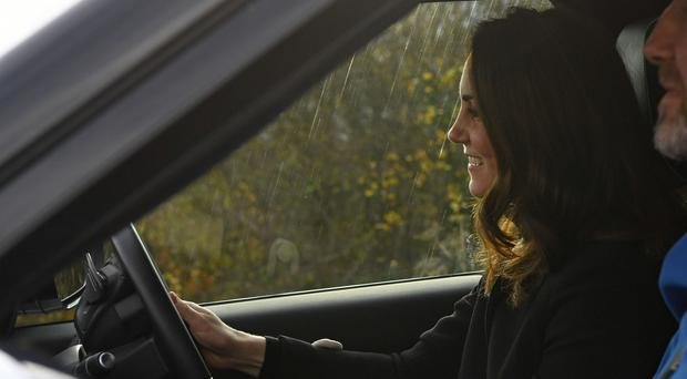 The Duke of Cambridge takes the wheel of a Land Rover Discovery (Paul Ellis/PA)