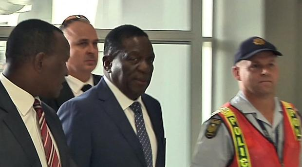 Emmerson Mnangagwa emerged from hiding on Wednesday, departing from neighboring South Africa to return home in preparation to take power after Robert Mugabe's stunning resignation. (AP)
