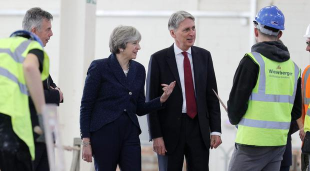 Prime Minister Theresa May and Chancellor Philip Hammond visit Leeds College of Building (Owen Humphreys/PA)