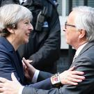 Theresa May welcomed Jean-Claude Juncker to Downing Street earlier in the year ( John Stillwell/PA)