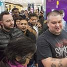 Shoppers wait outside the entrance to leading games retailer GAME in Westfield shopping centre in Stratford ahead of a Black Friday event (Rick Findler/PA)