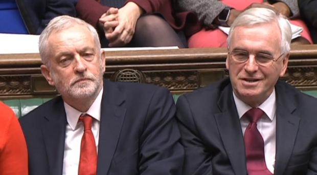 Jeremy Corbyn and John McDonnell during Prime Minister's Questions in the House of Commons (PA)