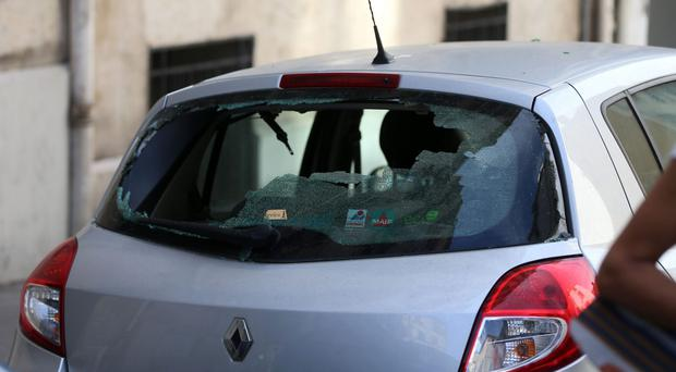 A smashed car window as vehicle vandalism in England and Wales has jumped by 10% in three years, police data shows (Niall Carson/PA)