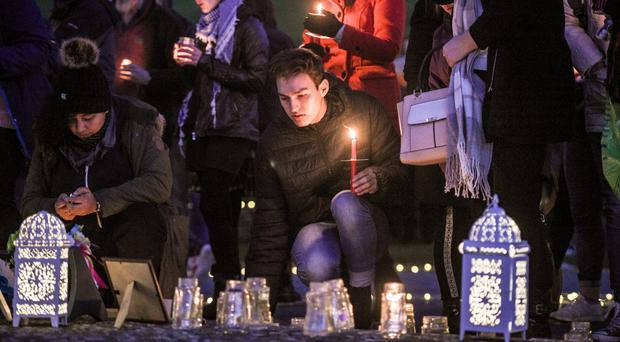 People take part in a candlelight vigil in the Prince Albert Gardens in Swanage (Ben Birchall/PA)