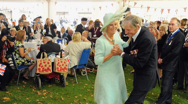 Jim Booth dancing with the Duchess of Cornwall (PA)