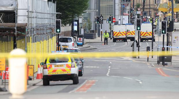 Police close to the Manchester Arena after the terror attack (Peter Byrne/PA)