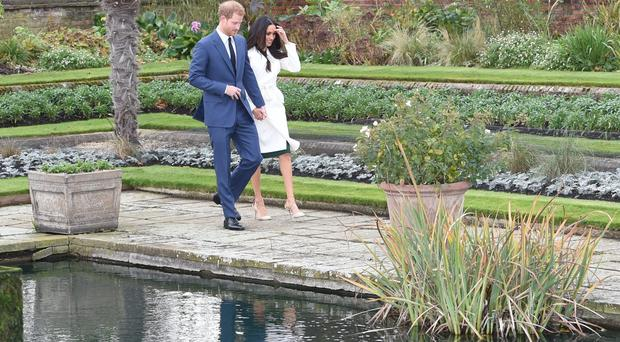 Prince Harry and Meghan Markle in the Sunken Garden at Kensington Palace, London, after the announcement of their engagement (Eddie Mulholland/Daily Telegraph/PA)