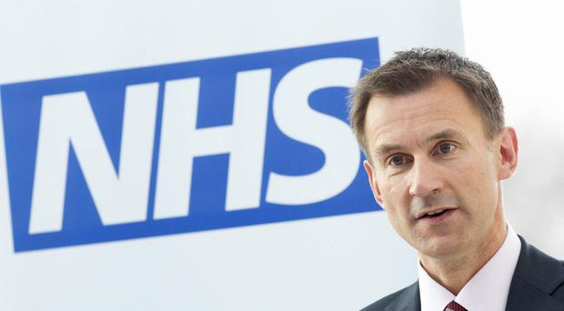 Jeremy Hunt will reveal he will look into enabling, for the first time, full-term stillbirths to be investigated by coroners (Neil Hall/PA)