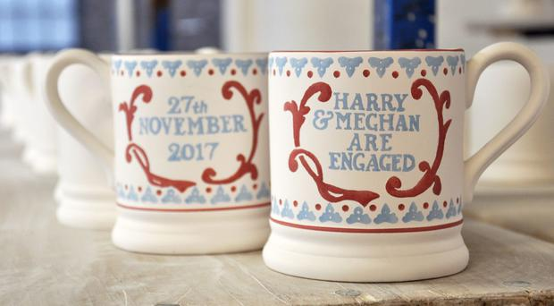 A souvenir mug commemorating Prince Harry and Meghan Markle's engagement (Emma Bridgewater/PA)