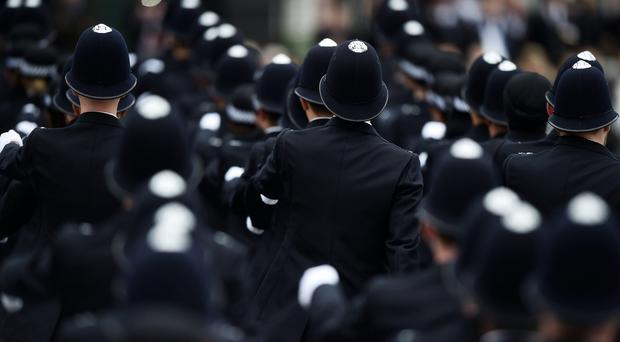 Police officers (Hannah McKay/PA)