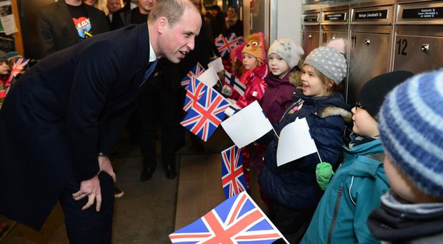 The Duke of Cambridge meeting children at an ice rink in Helsinki, Finland (Dominic Lipinski/PA)