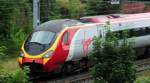 The RMT said around 1,800 Virgin Trains West Coast staff members will be involved in the strikes (Rui Vieira/PA)