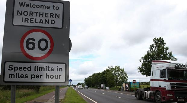 The border between the Republic of Ireland and Northern Ireland in the village of Bridgend, Co Donegal (Brian Lawless/PA)