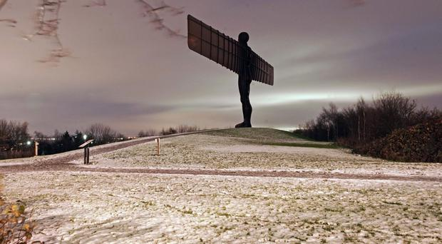 The Angel of the North in the snow near Gateshead (Owen Humphreys/PA)