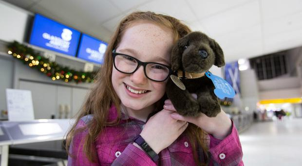 Eve Mcilquham has been reunited with her chocolate Labrador toy Basil after images of it were shared around the world (Glasgow Airport/PA)