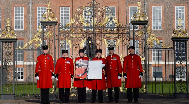 Chelsea Pensioners deliver a jumbo hand-signed engagement card to Prince Harry and Meghan Markle at Kensington Palace (Stefan Rousseau/PA)