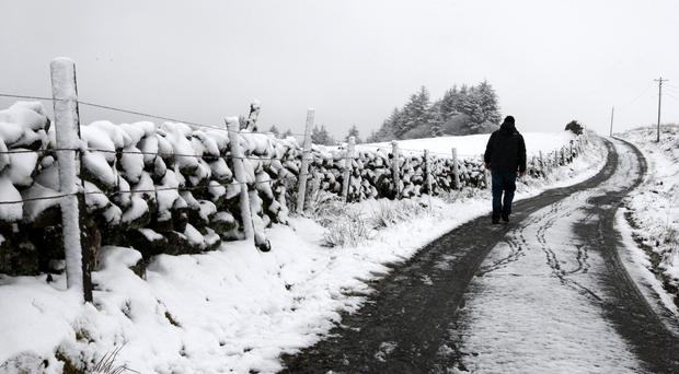 A walker in the snow in the hills in Scotland (Andrew Milligan/PA)