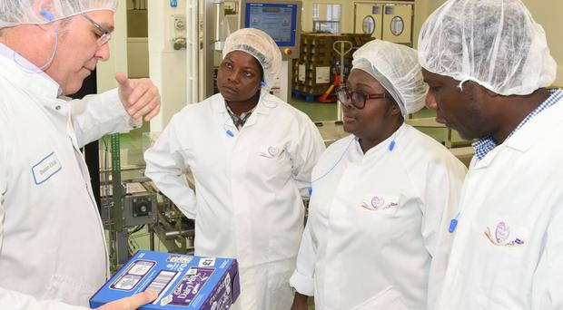 Cocoa farmers from Ghana visit the Bournville factory (Marie Hill/PA)