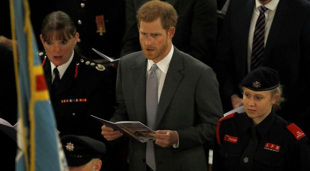 Prince Harry sings during the London Fire Brigade Carol Service at Westminster Cathedral (Peter Nicholls/PA)