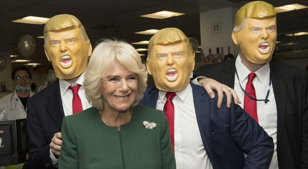 The Duchess of Cornwall and the three Trumps at ICAP during the broker's annual charity day in London (Arthur Edwards/The Sun/PA)