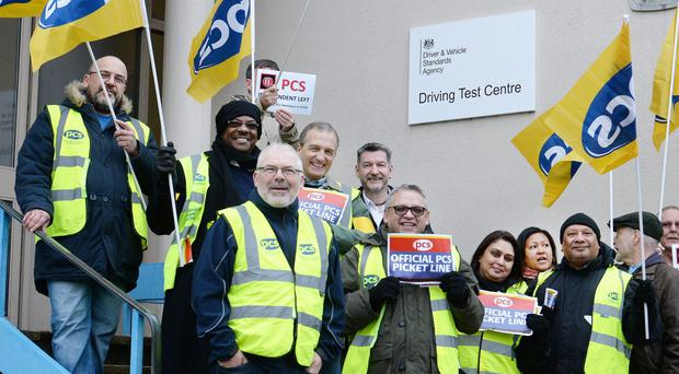 Driving test examiners on a picket line in Barnet, north London (John Stillwell/PA)