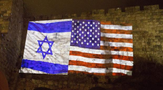 US and Israeli flags are projected onto the walls of Jerusalem's old city (Sebastian Scheiner/AP)