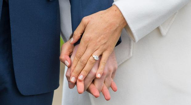 Meghan Markle's engagement ring as she holds hands with Prince Harry (Dominic Lipinski/PA)