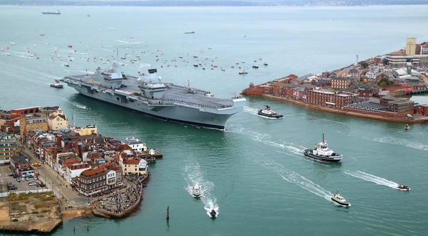 HMS Queen Elizabeth, the UK's newest aircraft carrier, arriving in Portsmouth (Gareth Fuller/PA)