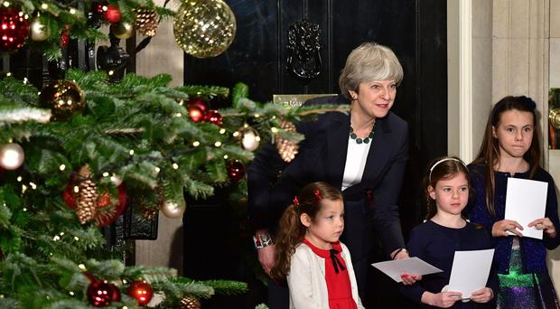 Theresa May has unveiled her Christmas cards (Dominic Lipinski/PA)