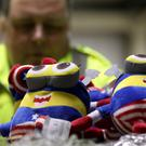 Border Force officer Robert Martin with children's toy seized at Southampton (Gareth Fuller/PA)
