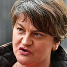 Arlene Foster's party worked with the Government into the early hours of Friday (Dominic Lipinski/PA)