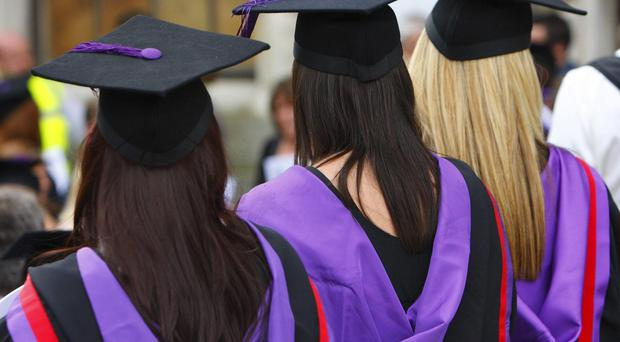 The proportion of young people from disadvantaged backgrounds entering higher education remains lower than for those from more prosperous backgrounds, a report found (PA)