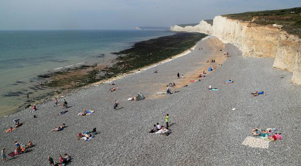 People on the beach at Birling Gap in Eastbourne, part of a stretch of coastline that was evacuated (Gareth Fuller/PA)