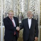 Iranian Foreign Minister Mohammad Javad Zarif, and Boris Johnson (Ebrahim Noroozi/AP)