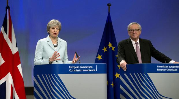 Theresa May with European President Jean-Claude Juncker (Virginia Mayo/AP/PA)