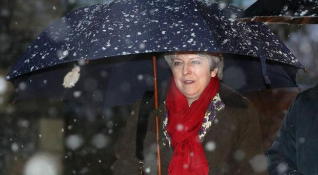 Theresa May is feeling optimistic about Brexit negotiations (Steve Parsons/PA)