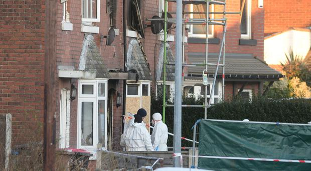Forensic officers at the scene of the house fire on Jackson Street in Worsley (Peter Byrne/PA)