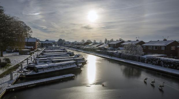 Canal boats in the frozen Shropshire Union Canal at Market Drayton (Peter Byrne/PA)