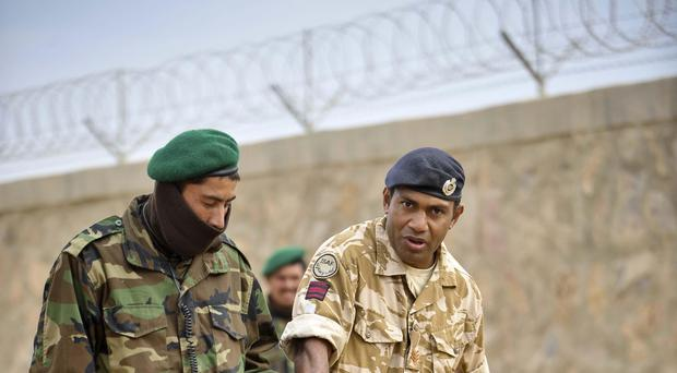 British soldiers and interpreters teaching Afghan soldiers (Ben Birchall/PA)
